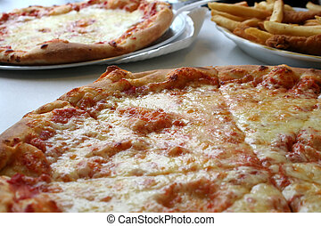 Pizza, Chicken and Fries - Cross-section of a large pizza...