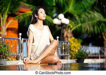 New age woman - Beautiful Thai woman sitting crossed leg in...