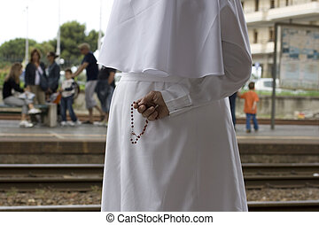 Catholic nun waiting a train