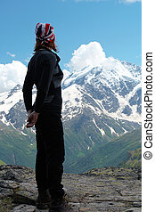 looking at the ultimate aim - girl hiker high at the...