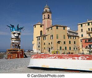 mediterranean village - bizarre jester mask on beach during...