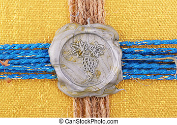 seal  - A silver seal as grapevine on golden background