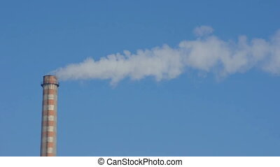 Industrial smoking chimney on blue