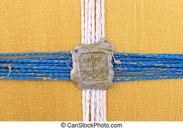 seal - A silver seal as anchor on golden background