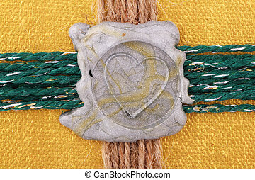 seal  - A silver seal as heart on golden background