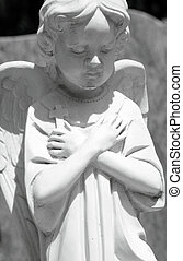 angel with cross - marble statue of angel holding a cross on...