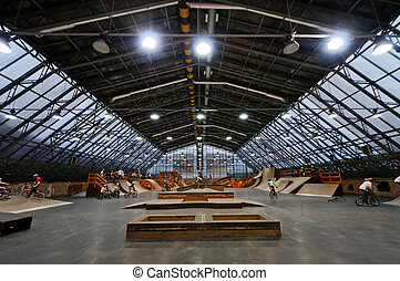 Skate park symmetric horisontal interior with bike riders