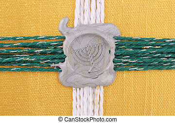 seal - A silver seal as chandelier on golden background