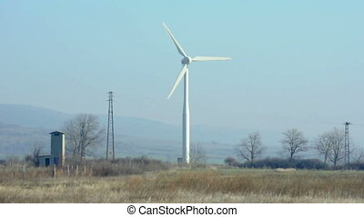 Wind generator on blue sky