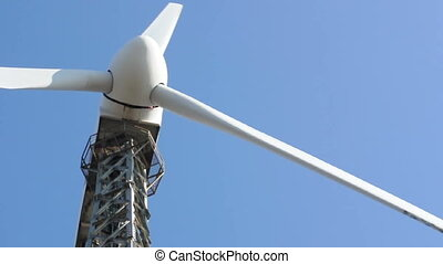 Wind generator on blue skyClose up propeller