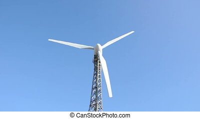 Wind generators on blue sky.Close u