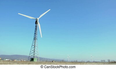 Wind generator on blue sky.Close up