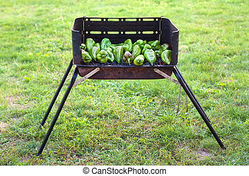 Barbecue - Grren peppers baking on a barbecue outside on the...