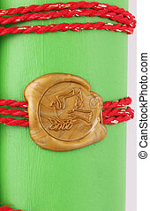 seal - A golden seal as dove on green background with a band