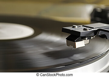 record player stylus over a rotating disc