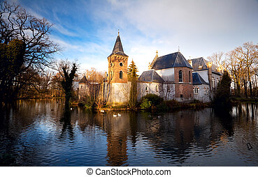 Dutch castle in Boxtel - castle in the middle of the lake in...