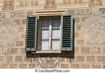 ornamental window - window with shutters on wall decorated...