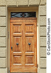 elegant wooden door - vintage wooden door framed with stone,...