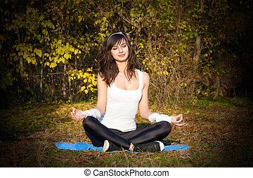 Yoga meditation - Attractive young woman doing yoga...