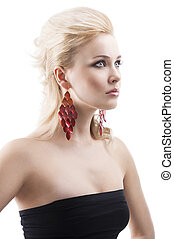 red earring on cute blond girl, she has searious expression