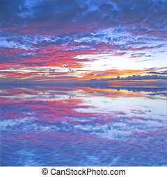 Abstract reflection - Evening sky with reflection in the...