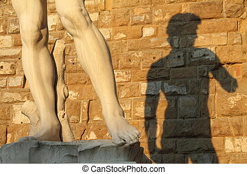 art in Italy - detail of David by Michelangelo and his...