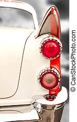 vintage Car Tail Lights - Tail lights and fin detail from an...