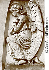 angelic figure - relief on antique wall