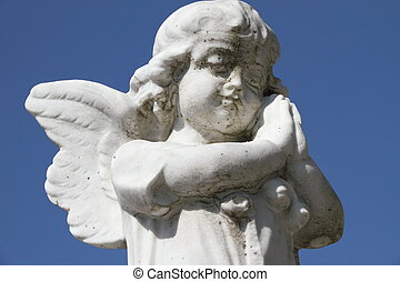 prayer - sculpture of little praying angel - isolated on sky...