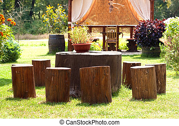 Stump furniture - Stumps used as table and chairs outside in...