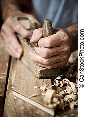 hands of a carpenter, close up - hands of a carpenter...