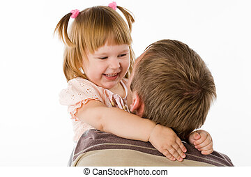 little girl and the father - little girl joyfully embraces...