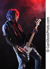 a bassist plays at a live concert