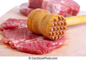 meat - Pieces of the crude cooled meat lie on chopping board...