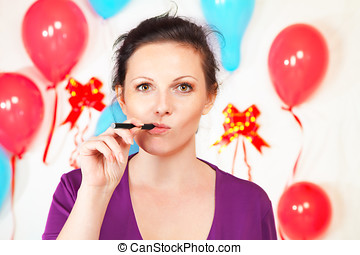 Woman with electronic cigarette against decorated wall