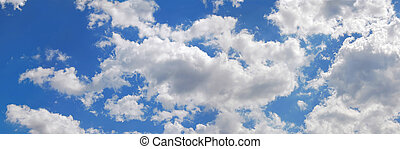 Blue sky with many cumulus white clouds.