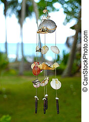 Wind chime - Windchime made of shells against the blurred...