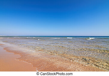 Seaview of coastline with tranquil water and blue sky