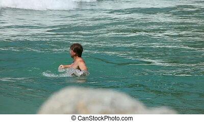 Man in ocean.