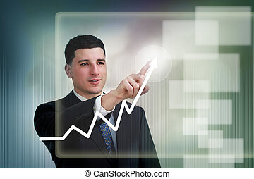 Businessman poiting to growth on a graph - Businessman...