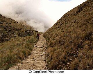 Tourist walking the Inca trail