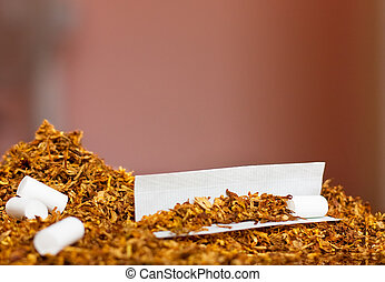 Hand rolling tobacco and paper - Tobacco rolling paper and...