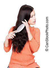 pretty woman combing her long black hair