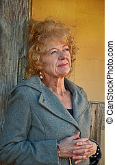 Thoughtful Middle Aged Woman in Rustic Setting - This...