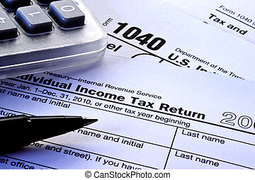 Tax Forms - Tax Return Forms - 1040 with pen and calculator...