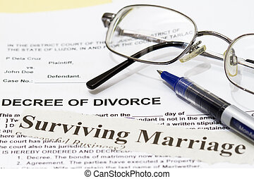 Surviving Marriage laid on a decree of divorce paper