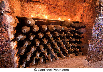 wine bottles with candles - stacked up wine bottles in the...
