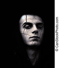 Young man with cracked skin - portrait of spooky looking man...