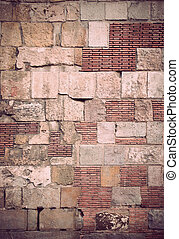 Brick wall - Brick and stone wall with many different...