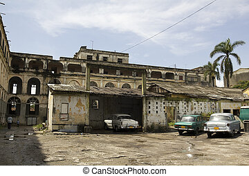 Cienfuegos - Scene in Cienfuegos. Cars parked inside a...